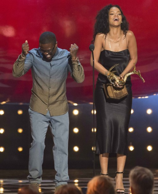 447387-singer-rihanna-accepts-the-most-desirable-woman-award-from-actor-kevin