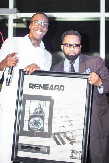 "​Reneard Being Presented a Commemorative ""Confessions of A Virgo"" Plaque by Greg Smith (SESAC) at the ""Confessions of A Virgo"" Album Release Party at Audi Atlanta"