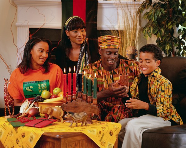 ca. 2001 --- Family Celebrating Kwanzaa --- Image by © Royalty-Free/Corbis