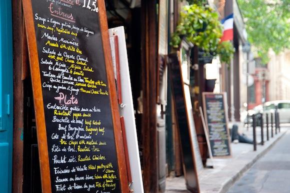 a sidewalk cafe chalkboard menu
