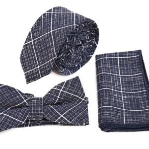 Zwarte stropdas in pakket met strik en zakdoek met witte lijn.