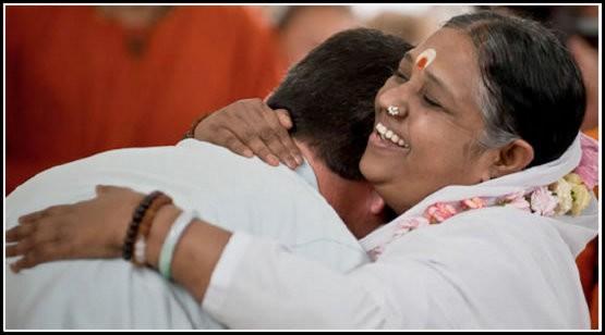 amma hug mama kerala india guru