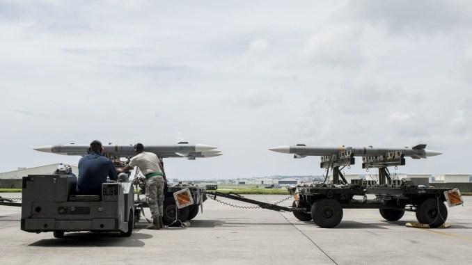 maintainers from the 18th aircraft maintenance squadron and pilots assigned to the 44th and 67th fighter squadrons conduct a mass aircraft generation exercise aug 22 and 23, at kadena air base, japan maintainers loaded aim 9 sidewinder missiles, aim 120 advanced medium range air to air missiles, flares, and m 61a1 cannon rounds onto f 15 eagles, before the aircraft taxied and were dispersed around the flight line kadena participates in a variety of routine training exercises throughout the year to maintain a consistent high standard of readiness and expertise f 15s assigned to kadena air base taxied on the flight line during a training exercise aug 23 while loaded with live ammunition this training was not in response to or in anticipation of any regional concerns while no planes took off from the flightline, this routine exercise helped ensure kadena's ability to provide air superiority in the defense of japan and promoting peace and stability throughout the indo asia pacific region us air force photo by senior airman peter reftreleased