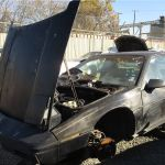 A 1985 Pontiac Fiero Econo Commuter In A Northern California Wrecking Yard