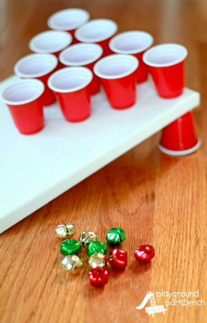 22 Fun Christmas Games   Activities for Kids   Holiday Kids Table Ideas jingle bell toss christmas game for kids