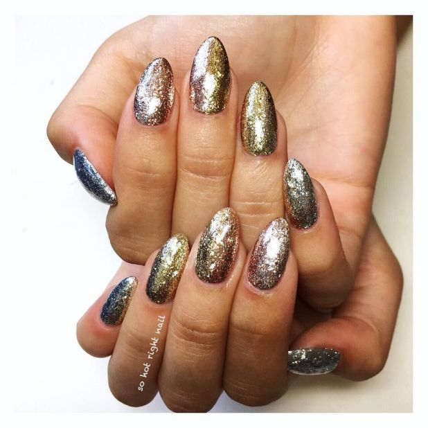 """<p>Combining the nail super forces of glitter polish and ombré is nail artistBel Fountain-Townsend<span class=""""redactor-invisible-space"""" data-verified=""""redactor"""" data-redactor-tag=""""span"""" data-redactor-class=""""redactor-invisible-space"""">'s """"Glitter Bombre"""". Fade your favorite shades of gold and copper from left to right for this high-shine look.</span></p><p><em data-redactor-tag=""""em"""" data-verified=""""redactor"""">Design by<span class=""""redactor-invisible-space"""" data-verified=""""redactor"""" data-redactor-tag=""""span"""" data-redactor-class=""""redactor-invisible-space""""></span><a href=""""https://www.instagram.com/p/BLj4u4KheR2/"""" target=""""_blank"""">@sohotrightnail</a></em><span class=""""redactor-invisible-space"""" data-verified=""""redactor"""" data-redactor-tag=""""span"""" data-redactor-class=""""redactor-invisible-space""""><em data-redactor-tag=""""em"""" data-verified=""""redactor""""></em></span></p>"""