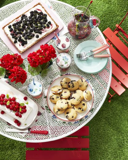 table filled with delicious treats made from fresh berries including whoopie pies, a tart, and refreshing drink