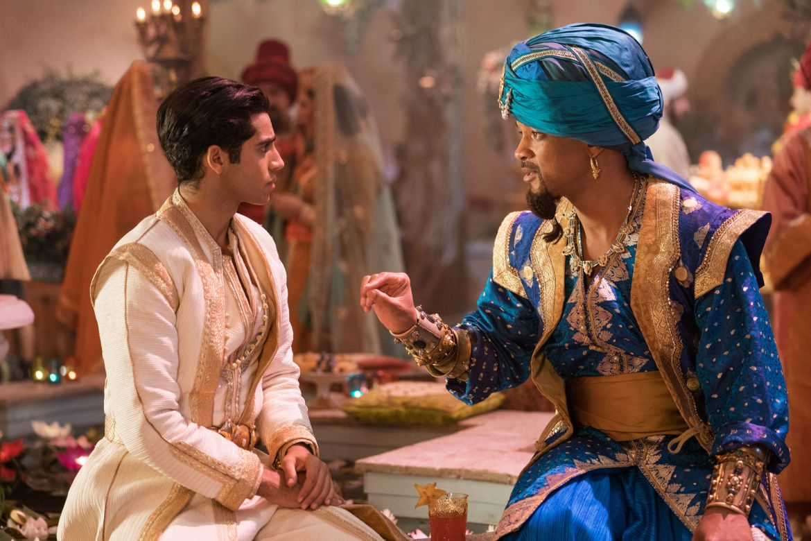Mena Massoud and Will Smith as Aladdin and Genie
