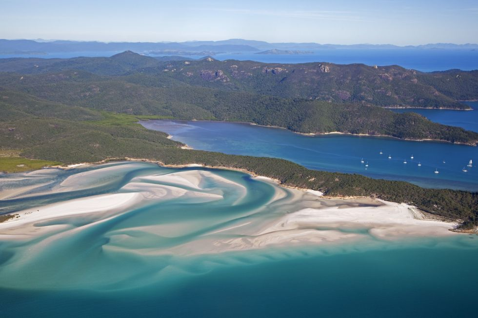 Areal view of white sandy beaches and turquoise blue water of Whitehaven Beach on Whitsunday Island in the Coral Sea
