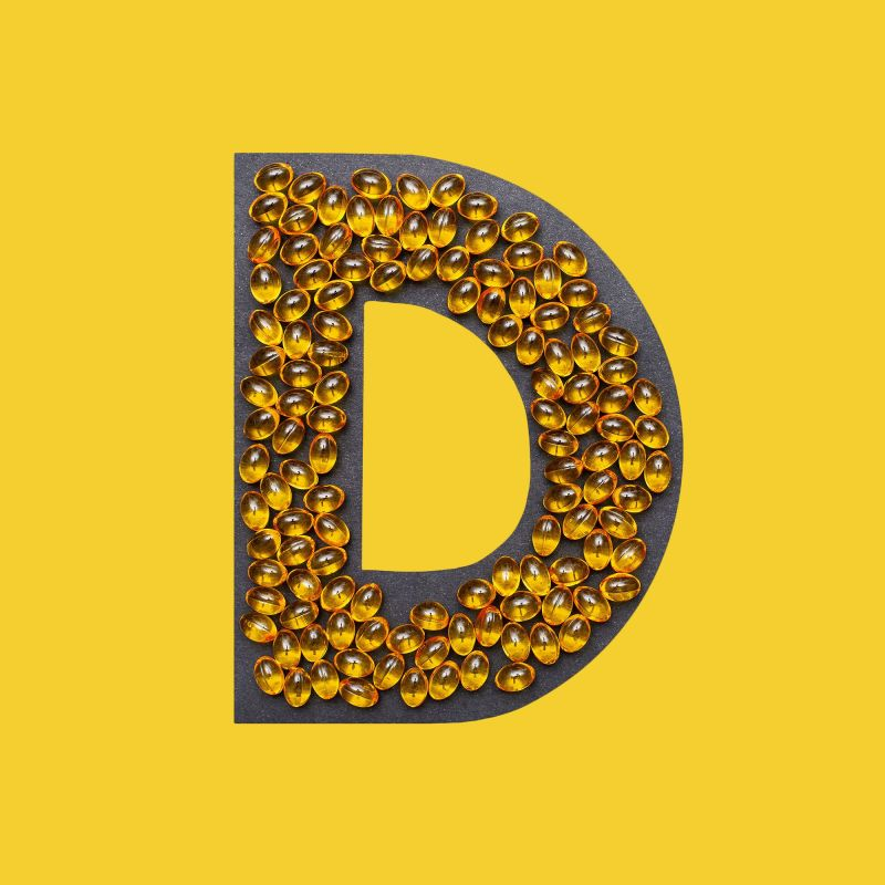 vitamin capsules in the shape of the letter d