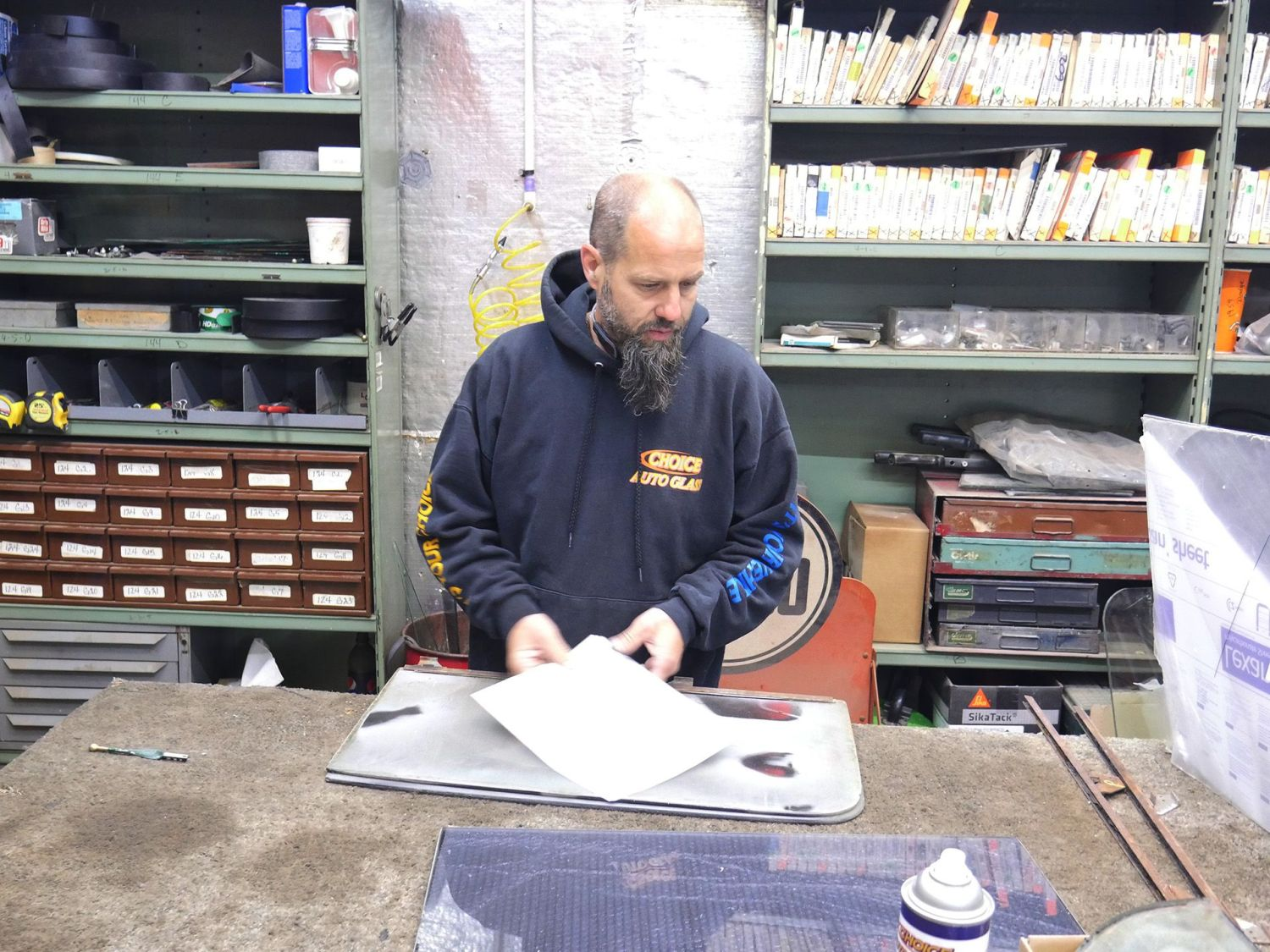 glass specialist dale buckingham in his shop