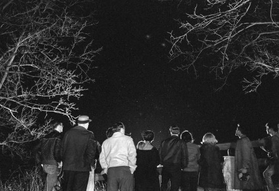 Towns People Watching Night Sky For UFOs
