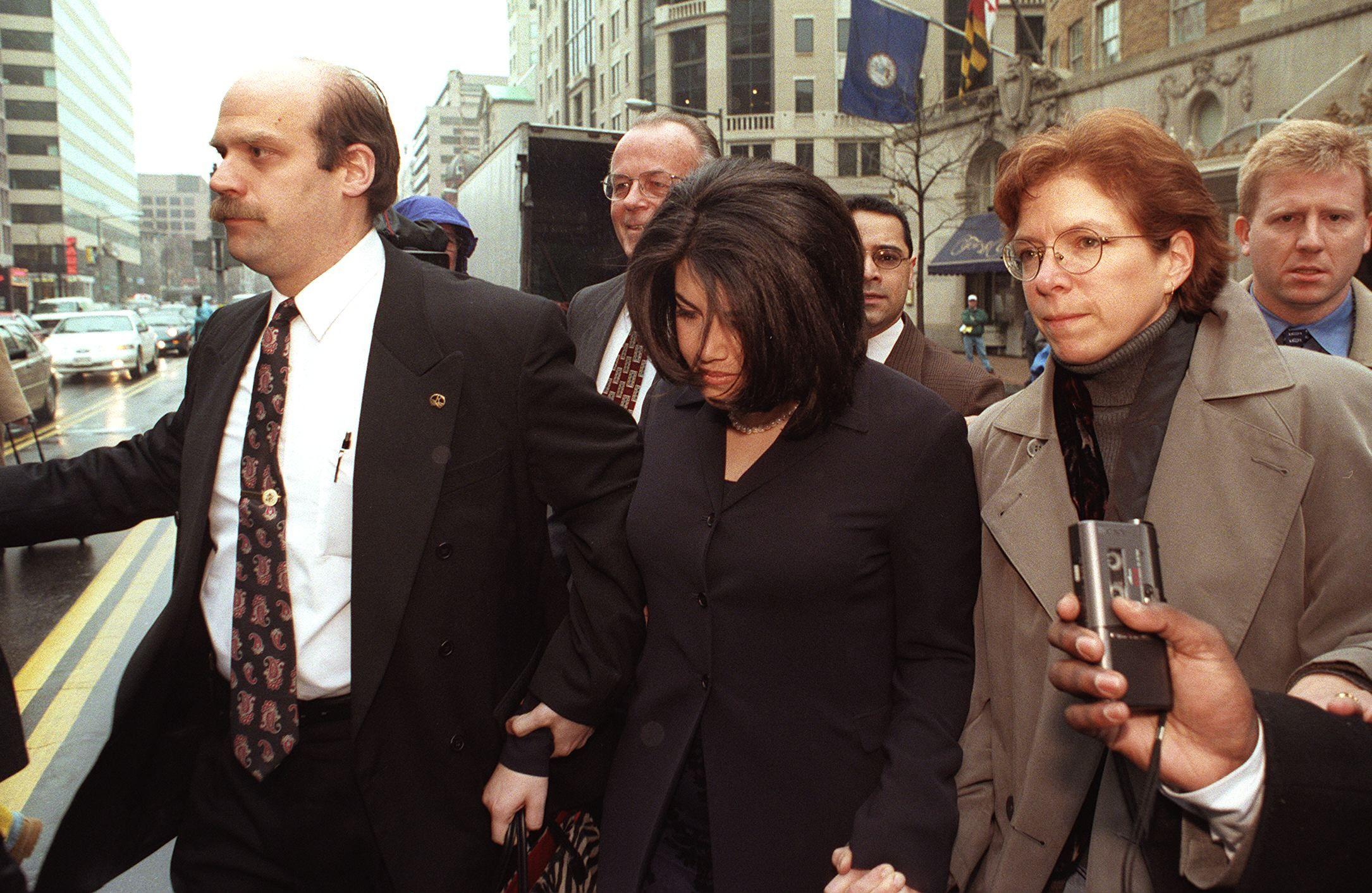 Former White House intern Monica Lewinsky(C) is es