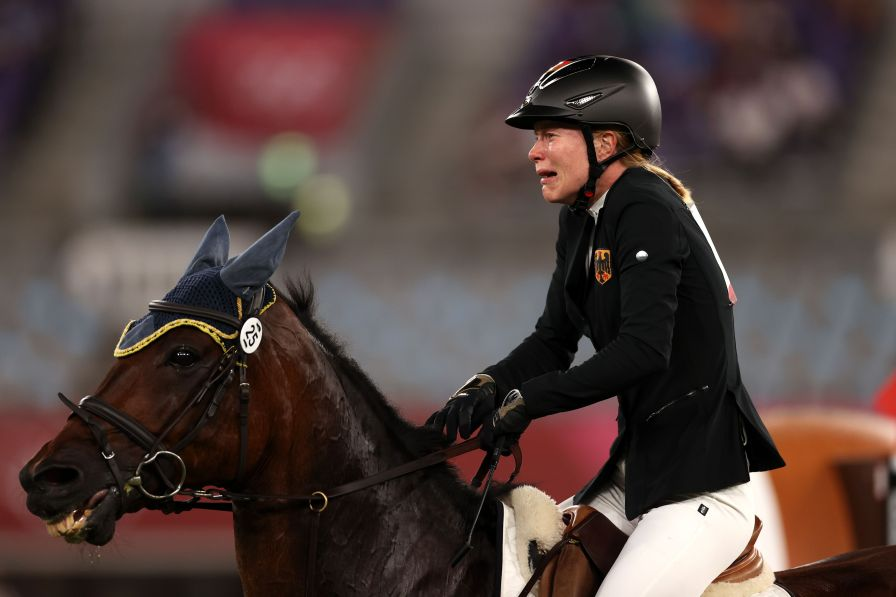 chofu, japan august 06 annika schleu from team germany looks worn out after her race in the equestrian show jumping of women's modern pentathlon on day fourteen in tokyo 2020 olympic games at tokyo stadium on august 6, 2021 in chofu, japan photo by dan mullangetty images
