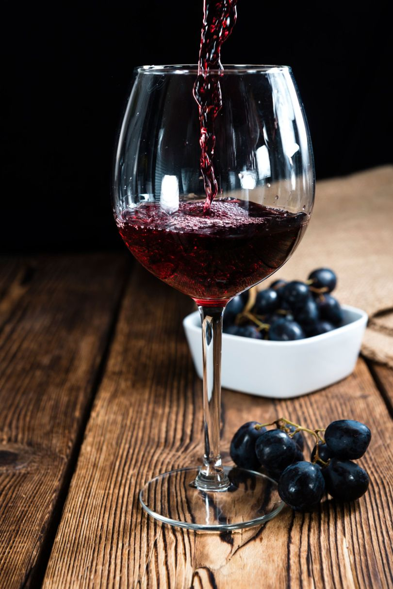 Red Wine (on wooden background)
