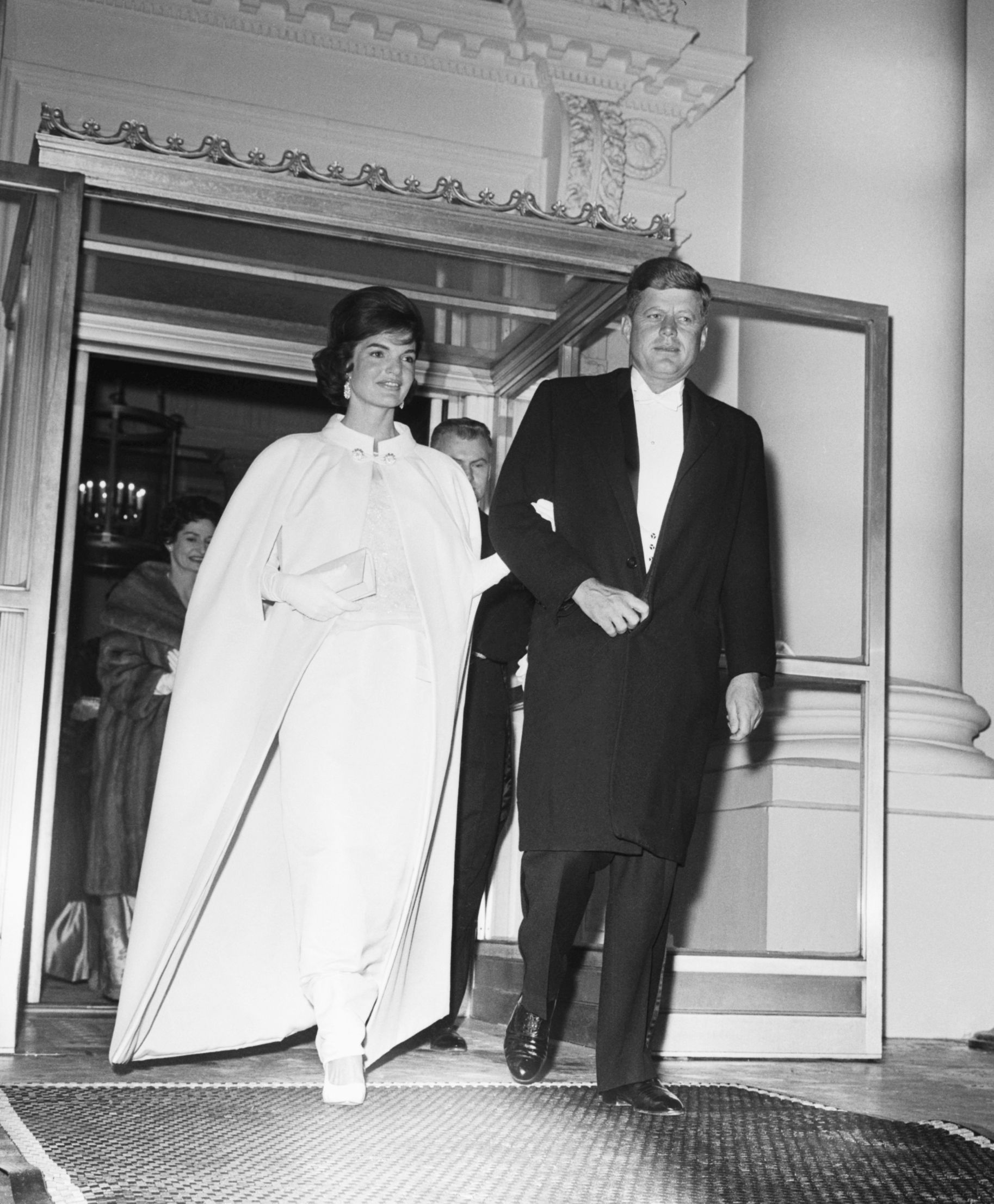 original caption 1201961 washington, dc full shot of the president and mrs john f kennedy as they left the white house to attend a series of inaugural balls five locations were set aside to accommodate the huge crowd that wanted to attend the first lady's dress was designed by oleg cassini