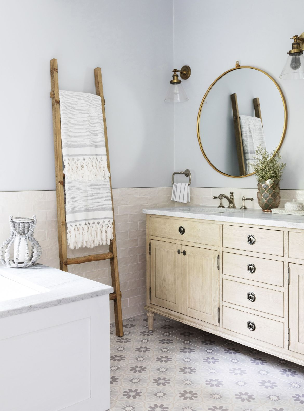 home featuring warm neutrals and soothing blue hues to accent the beautiful architecture of the vintage home interior designer karen b wolf bathroom with ladder as towel rod