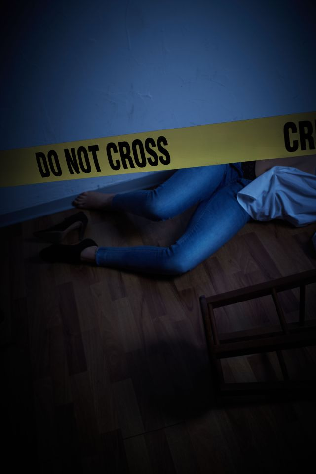 high angle view of dead woman on floor with cordon tape at home