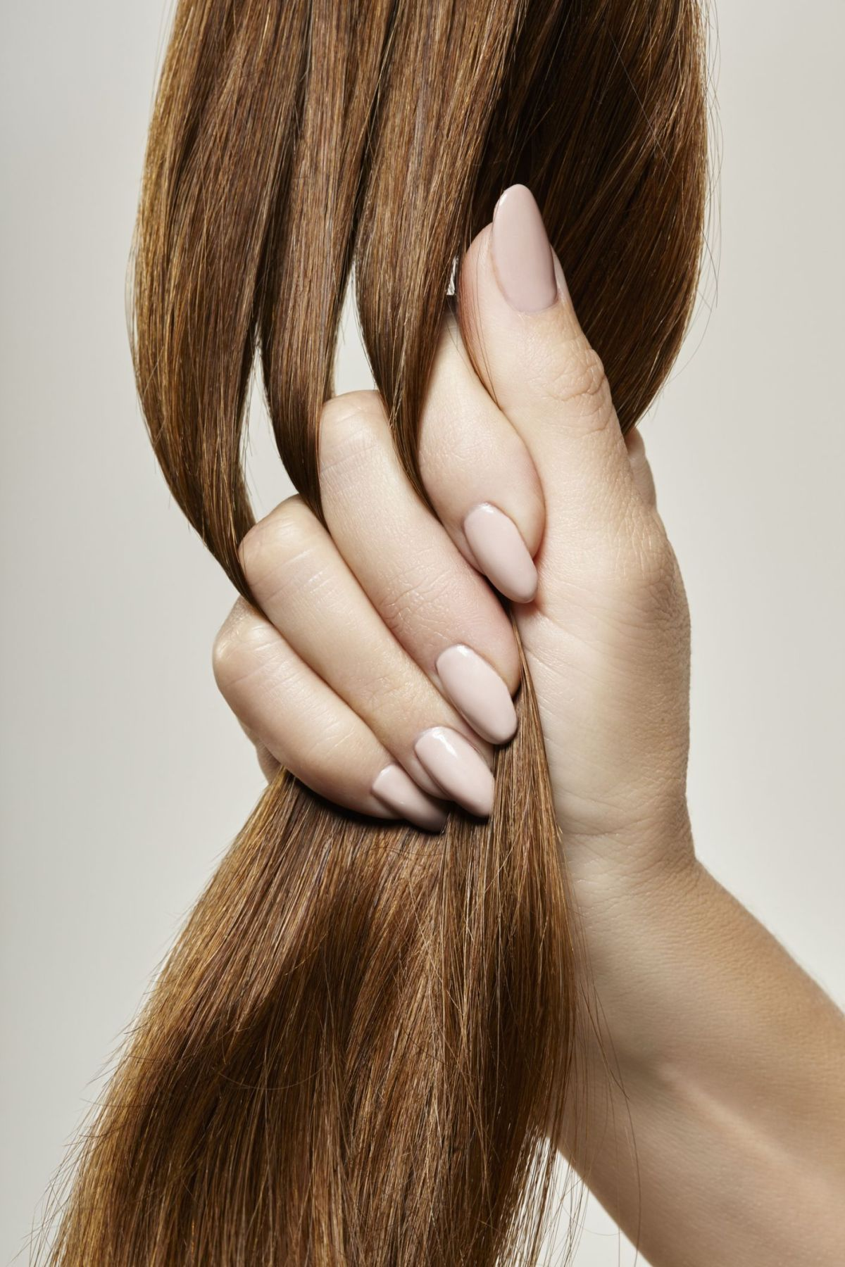 human female hand holding brown hair high res stock photography 652974212