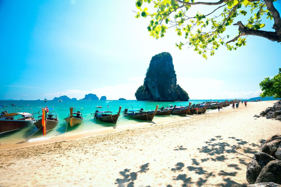 Longtale boats on Railay beach in Krabi Thailand. Asia
