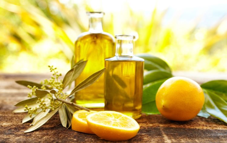 Massage oil bottles with lemons and olive branch