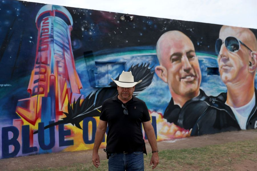 van horn, texas   july 19 david morales stands near a mural on the side of his building he had painted to honor jeff bezos as the billionaire plans to launch his blue origin rocket from a launchpad in west texas on july 19, 2021 in van horn, texas mr bezos is scheduled to lift off from the launch pad at 8 am local time on tuesday in the blue origin's suborbital new shepard rocket in the first human spaceflight for his company mr bezos is to be joined by his brother mark bezos, 18 year old oliver daemen, and 82 year old wally funk photo by joe raedlegetty images