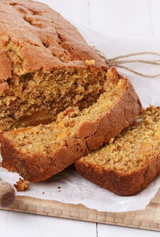 Pumpkin bread loaf over white wooden background