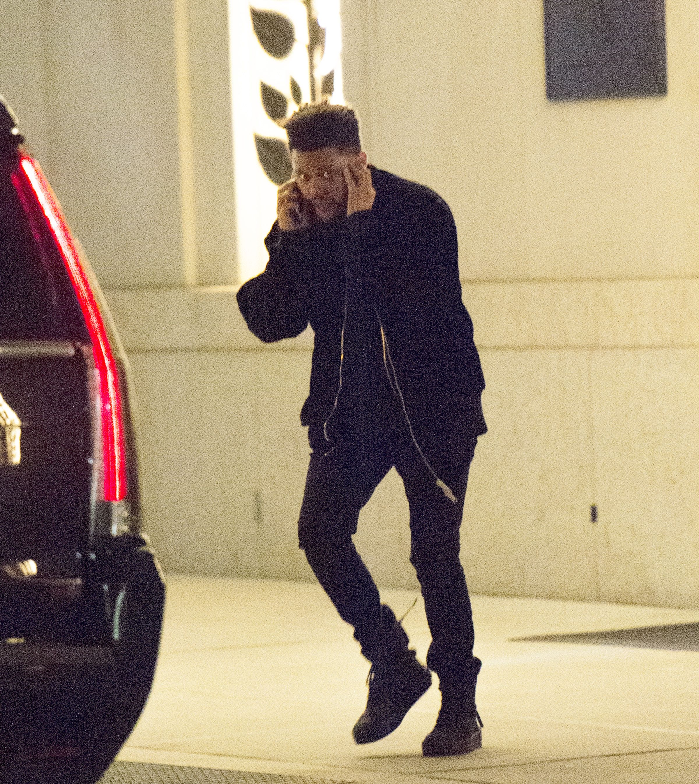 The Weeknd leaving Bella Hadid's apartment
