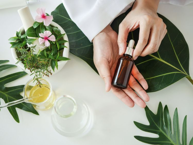 the scientist,dermatologist with the organic natural product in the laboratory.research and development beauty skincare concept.blank package,bottle,container .cream,serum.hand