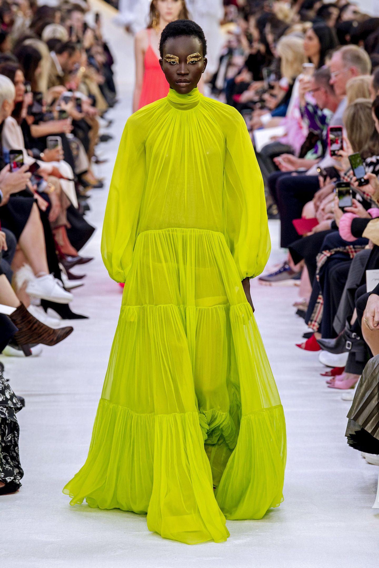 Fashion, Fashion model, Runway, Fashion show, Clothing, Yellow, Haute couture, Shoulder, Dress, Event,