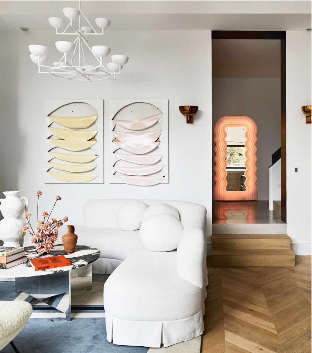 White, Interior design, Room, Living room, Furniture, Property, Wall, Yellow, Orange, Ceiling,