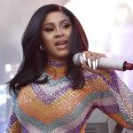 Cardi B performs in a bathrobe after suffering a wardrobe malfunction at Bonnaroo
