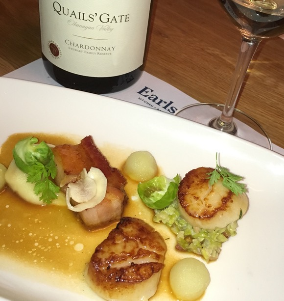 Quails Gate Stewart Family Reserve Chardonnay, smartly paired with Earls slow cooked pork belly and pan roasted scallops