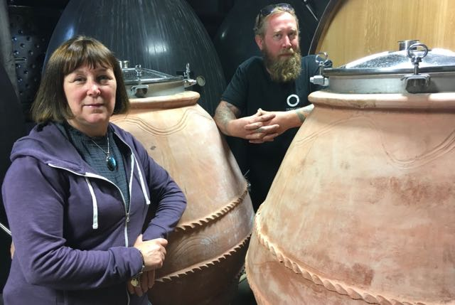 Natural winemakers Christime Coletta and Matt Dumayne with their amphorae
