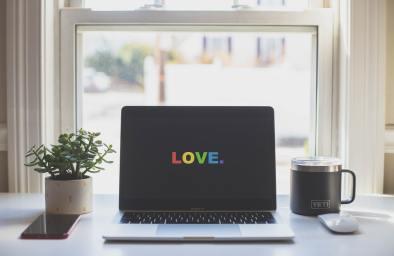 "Pride computer wallpaper reading ""LOVE."""