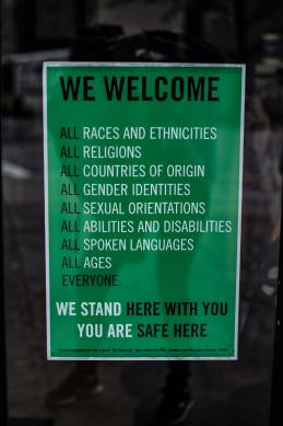 diversity and inclusion in the workplace. sign reading all are welcome and supported here.