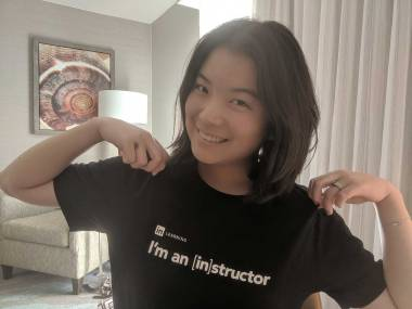 "Profile image of Hiro Nishimura wearing a black T-Shirt that says ""I'm an instructor."""