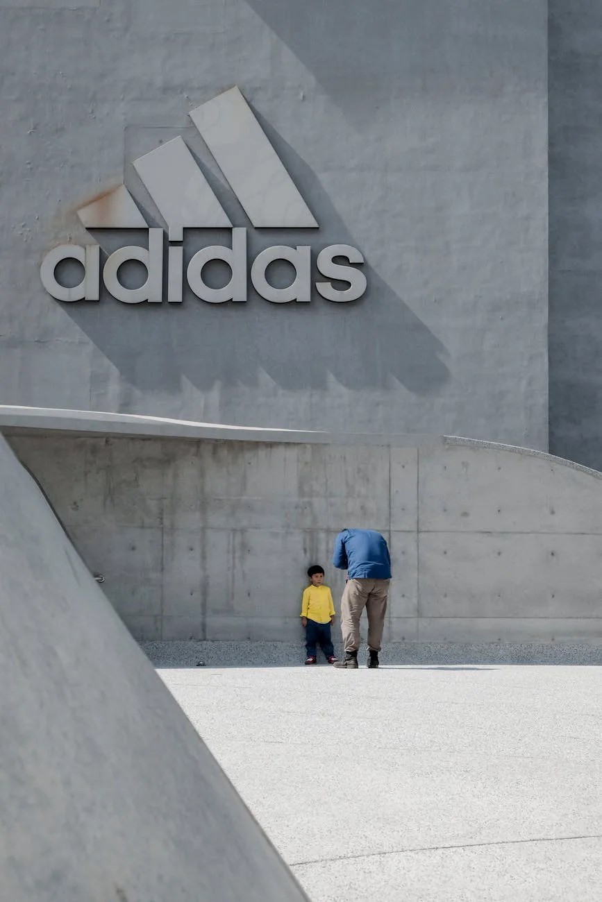 man taking photo of a child leaning on wall