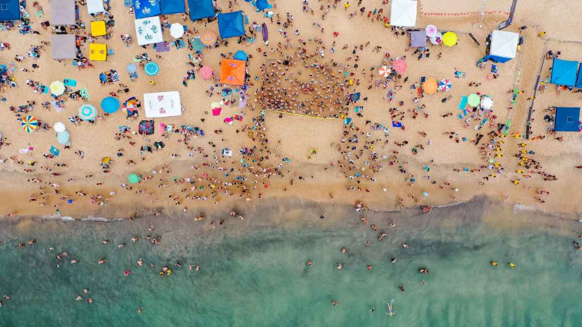 crowded sandy beach on summer vacation