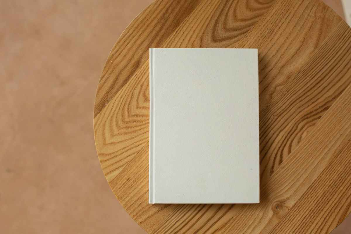 empty white book on wooden table