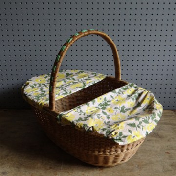Cloth-covered wicker picnic basket