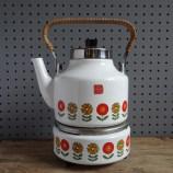white enamel kettle with flower border