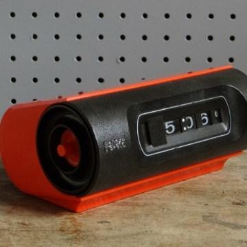 orange Sankyo flip alarm clock