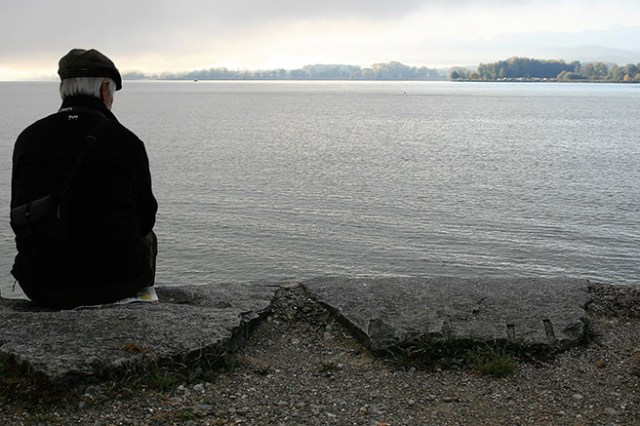 Man sitting on his own looking out to sea