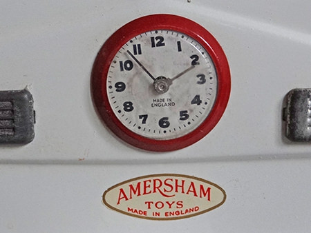 Detail showing the clock on the vintage Amersham toy cooker