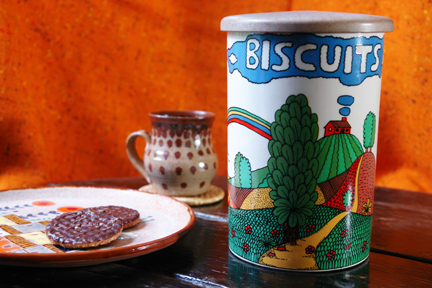 vintage Crown Devon pottery biscuit barrel with plate of biscuits and handmade pottery mug