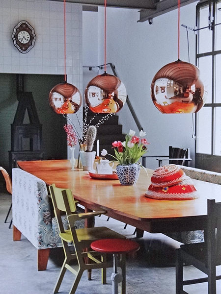 Copper lights above a dining table