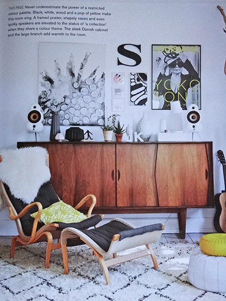 mid century modern styled room with teak sideboard