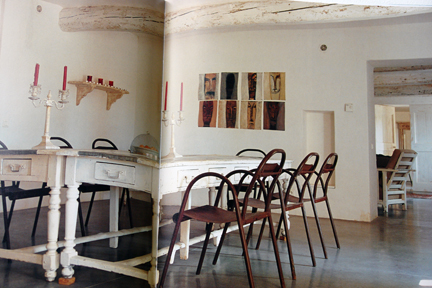 """double page spread showing whitewashed dining table with metal bistro-type chairs from """"The Way We Live In the Country"""" by Stafford Cliff & Gilles de Chabaneix"""