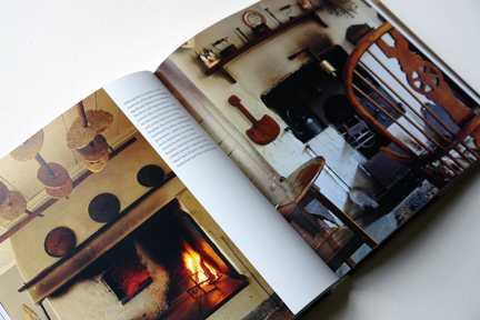 """double page spread showing an open fire with oatcakes drying above and a rustic, antique cast iron stove from """"The Way We Live In the Country"""" by Stafford Cliff & Gilles de Chabaneix"""
